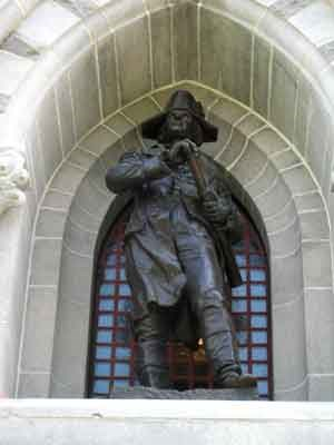 Life-sized bronze statue of American General Horatio Gates.  He holds a small telescope and looks into the distance.
