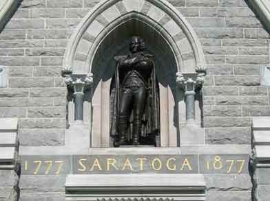 "Bronze statue of American General Philip Schuyler.  Beneath his feet reads ""1777 Saratoga 1877""."