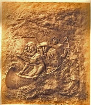 Bronze plaque portraying Lady Harriet Ackland and a few others on a small boat, headed under a flag of truce toward American positions.