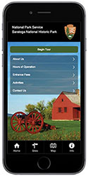 Simulated cell phone image displaying a park tour app. A small, historic, red house, a red cannon carriage, green lawn and blue sky are also visible.