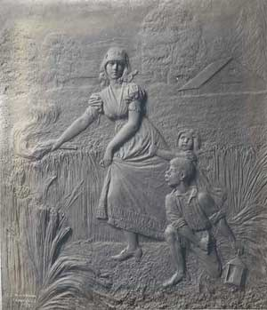 Bronze plaque portraying Catherine Schuyler setting fire to the wheat fields at her family's country estate.