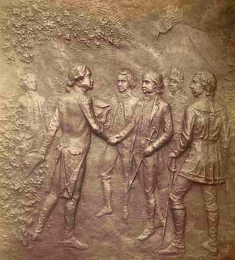 Bronze plaque portraying British General John Burgoyne surrendering to American General Horatio Gates.