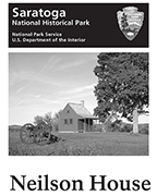 Grayscale image of a partial brochure cover showing a small one-room farmhouse.