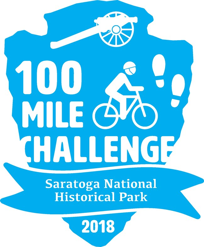 Arrowhead outline with cyclist and footprints and text reading 100 mile challenge