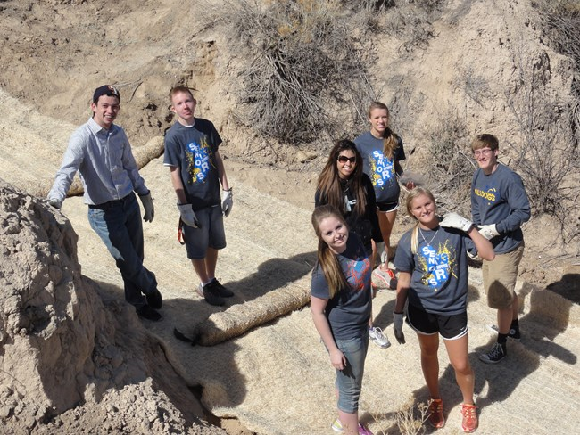 High school group working on erosion control