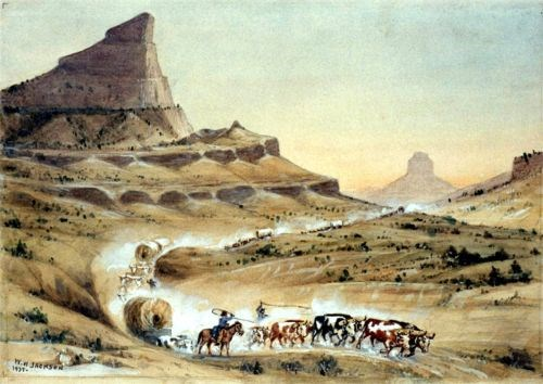 Depicts covered wagons go making their way through Mitchell Pass at what is now Scotts Bluff National Monument in western Nebraska.