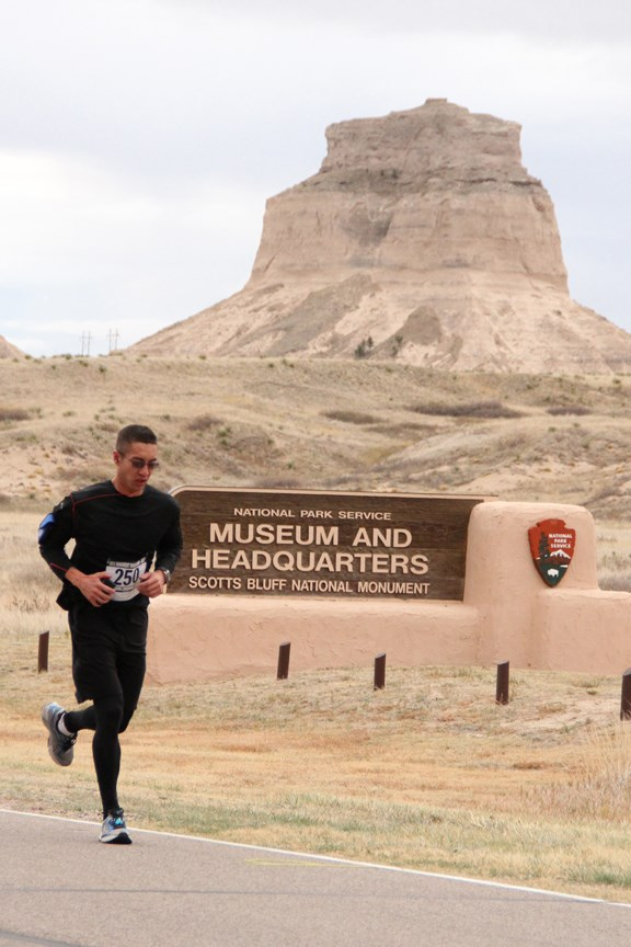 Marathon runner passing Dome Rock