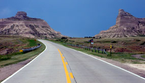 Heading west on highway 92 towards the Scotts Bluff National Monument.  Sentinel Rock is seen on the left, and Eagle Rock is seen on the right.