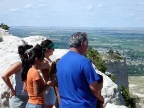 Visitors looking over the city of Scottsbluff from the summit of the Scotts Bluff National Monument