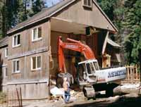 Excavator demolishes old Upper Kaweah guest lodging