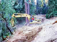 Excavator reworks the grade of a steep hill in Giant Forest