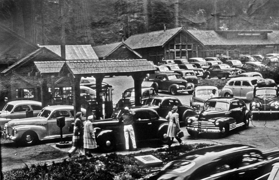 Vintage cars crowd around the old Giant Forest market and gas station.