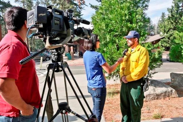 A fire information officer gives an interview.