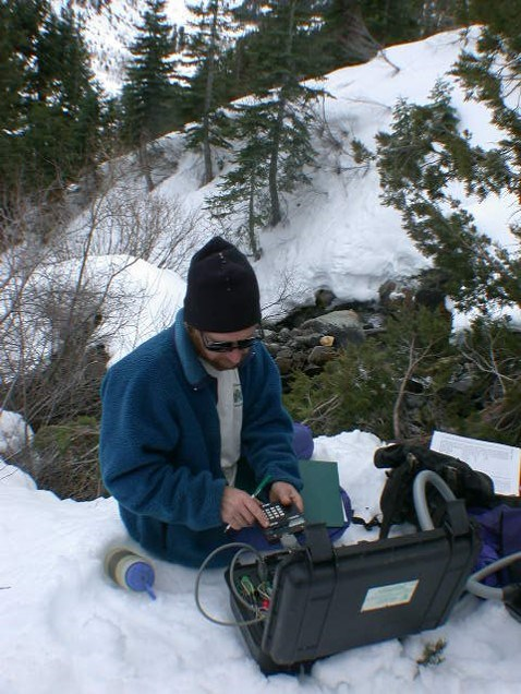 Cave specialist collects data on karst system in park.