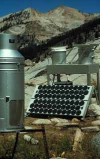 A solar powered, aerochemetric rain sampler and rain gauge collect precipitation and dry atmospheric deposition data at Emerald Lake in Sequoia National Park.