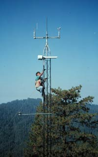 Person climbs meterological tower to check instruments