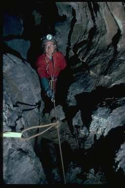 Joel Despain at the top of the rope leading to Betelgeuse Balcony in Hurricane Crawl Cave