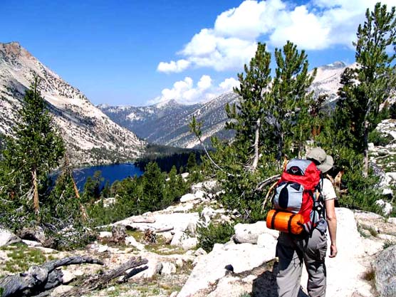 Hiker on John Muir/Pacific Crest Trail above Charlotte Lake in Kings Canyon National Park