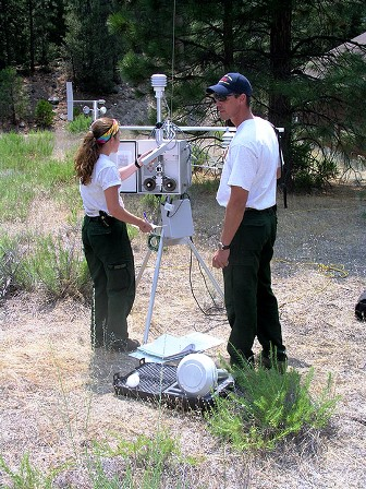 Firefighters monitor the measurements at one of the parks' E-BAMs.