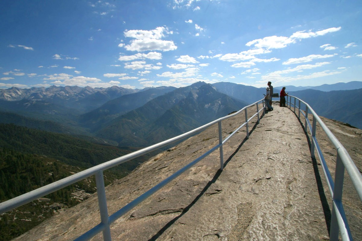 People admire views from within the narrow railing at the top of Moro Rock. Photo courtesy of Paul Johnson.