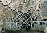 Crystal Cave's spiderweb gate