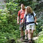 Two backpackers make their way down a rocky trail in Shenandoah National Park.