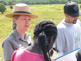 Teacher-Ranger confers with students