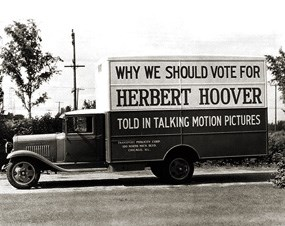 "A truck displaying the message ""Why we should vote for Herbert Hoover."""