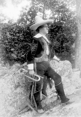 George F. Pollock in costume with bugle at Skyland.
