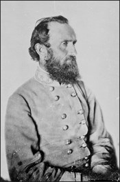 Historic photo of Stonewall Jackson; seated, posed in uniform.