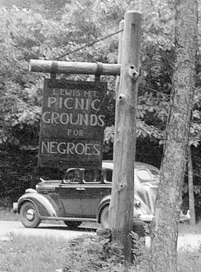 Wooden park sign: 'Lewis Mt Picinic Grounds for Negroes'