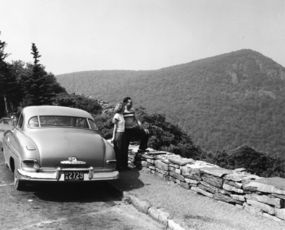 A couple pausing to take in a scenic view from Skyline Drive.