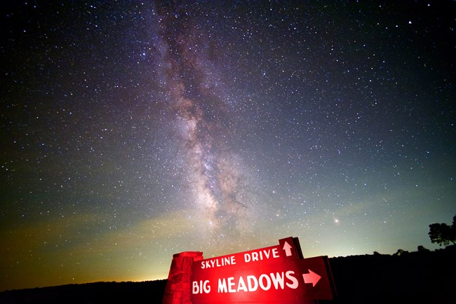 The Milky Way Galaxy shines over the Skyline Drive sign at Big Meadows.