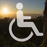 Accessibility logo over an sunset