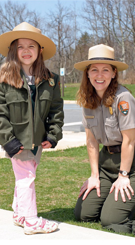 A ranger and a young visitor dressed up like a ranger at National Junior Ranger Day in Shenandoah.