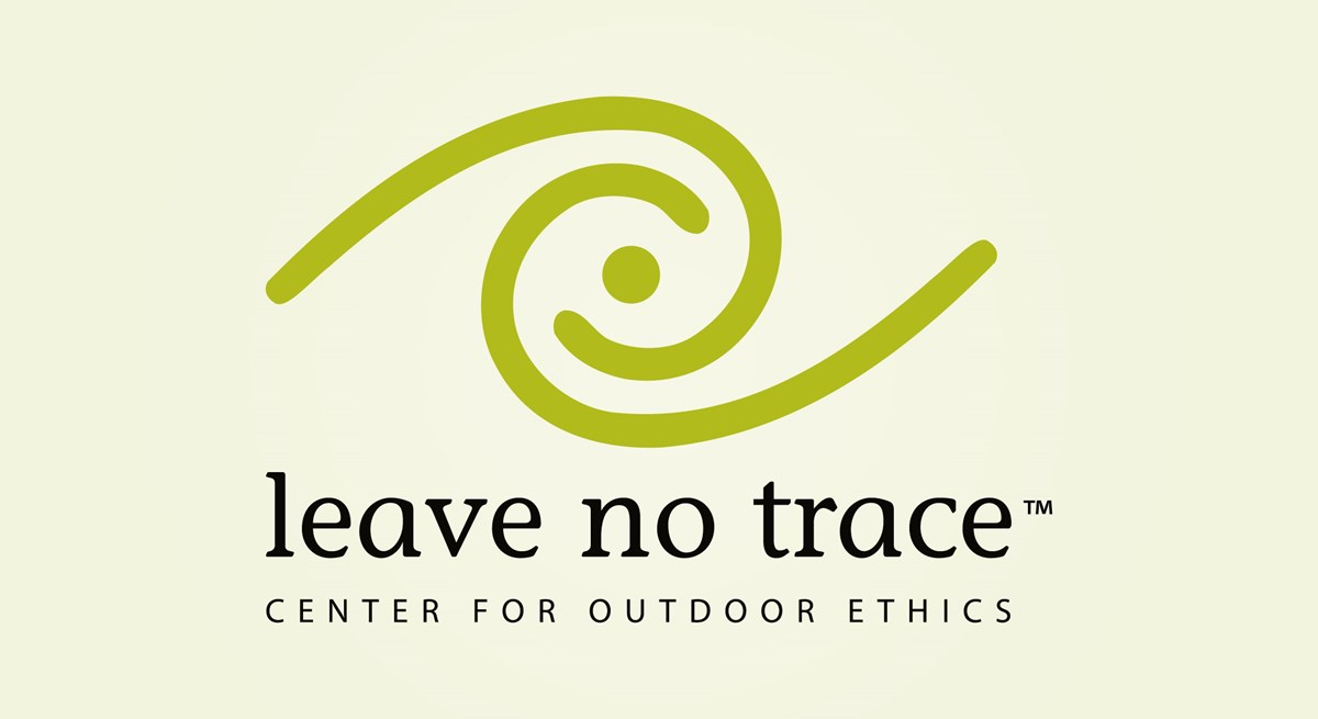 A logo of a green swirl with the words: Leave No Trace Center for Outdoor Ethics