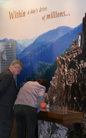 Two Shenandoah visitors learn about the creation of Shenandoah National Park while viewing the exhibit at Byrd Visitor Center.