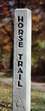 A horse trail sign post marking some of the 180 miles of horse trails in the park.