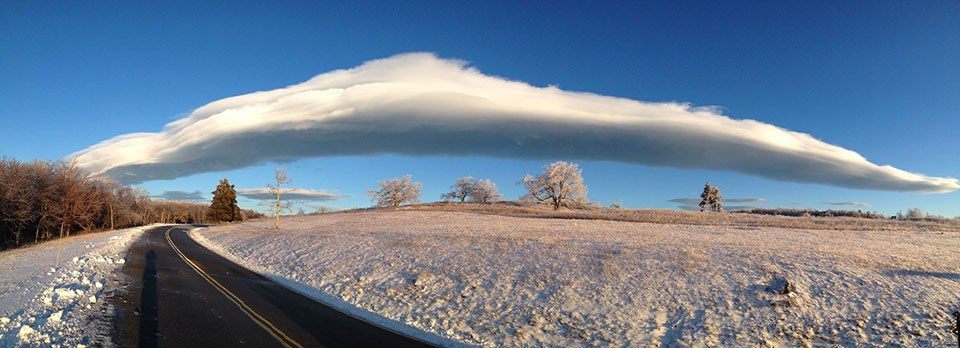 wide angle photo of a snowy Big Meadows with clouds on Skyline Drive