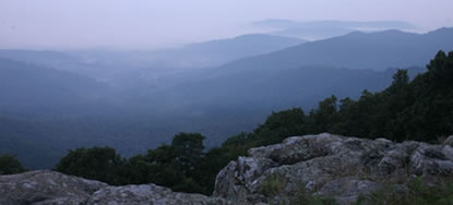 Misty fog and soft morning light create the color which gave the Blue Ridge Mountains their name.