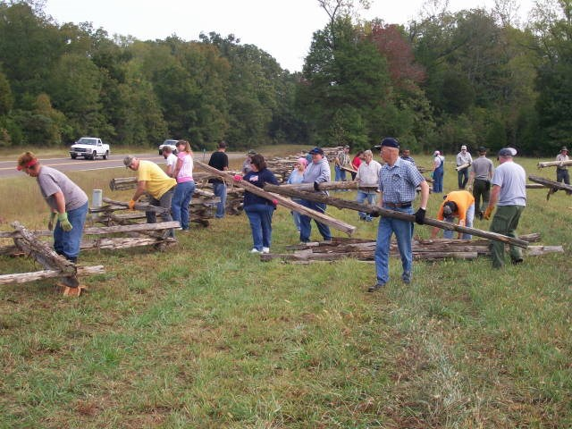 Volunteers erecting a fence during NPLD 2012