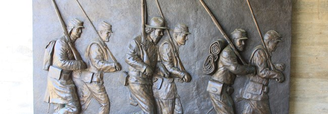 Sculpture of marching soldiers at Corinth Civil War Interpretive Center
