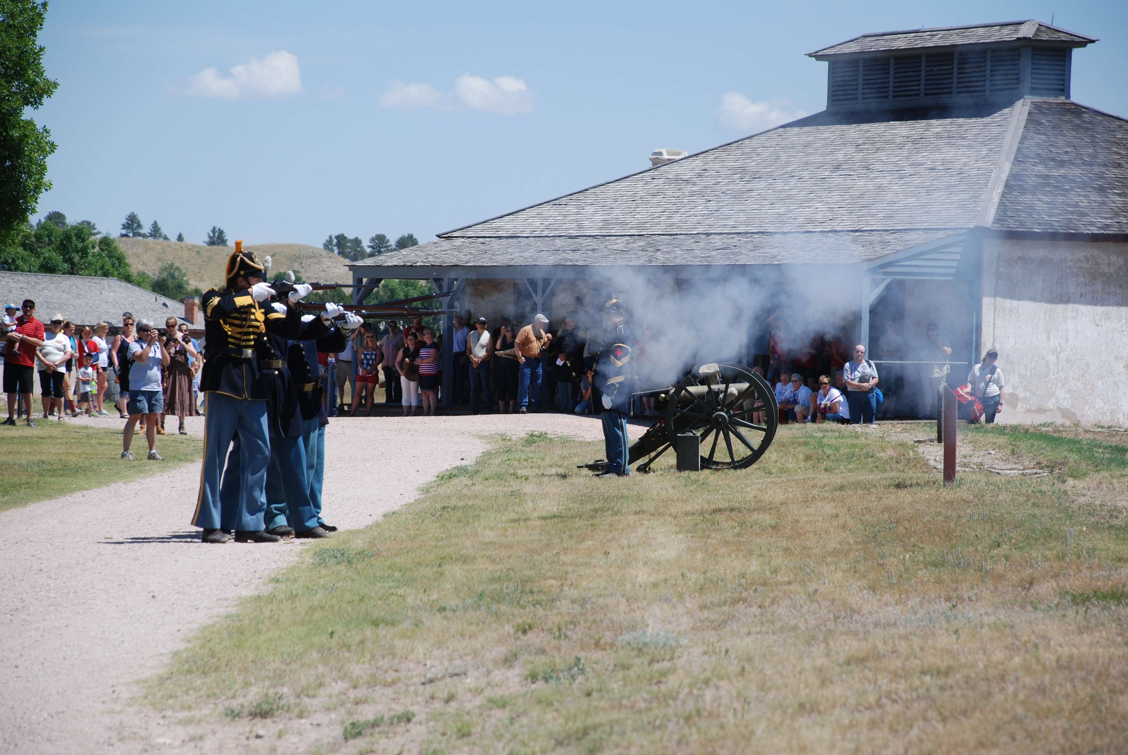 Rifle salute on Fourth of July with artillery.