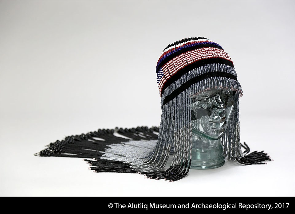 Headdress of red, white, black, blue, and grey beads.