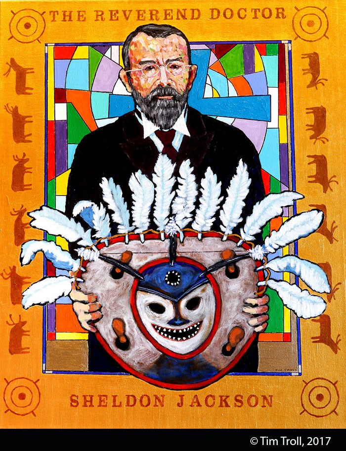 Stylized painting of a man with brown hair and beard, wearing glasses and a suit, holding a large painted and feathered Alaska Native mask. Gold paint frames the image.