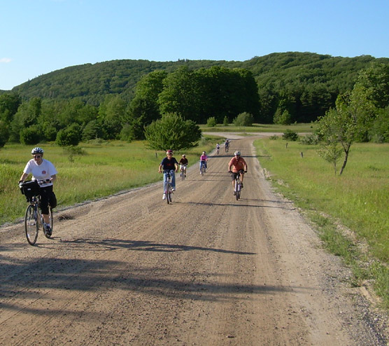 Visitors enjoy bicycling the back roads of Sleeping Bear Dunes National Lakeshore.