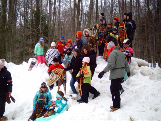 Children enjoy a Park Ranger-led snowshoe hike at a Sleeping Bear Dunes National Lakeshore FUN event.  Photo courtesy of the National Park Service.