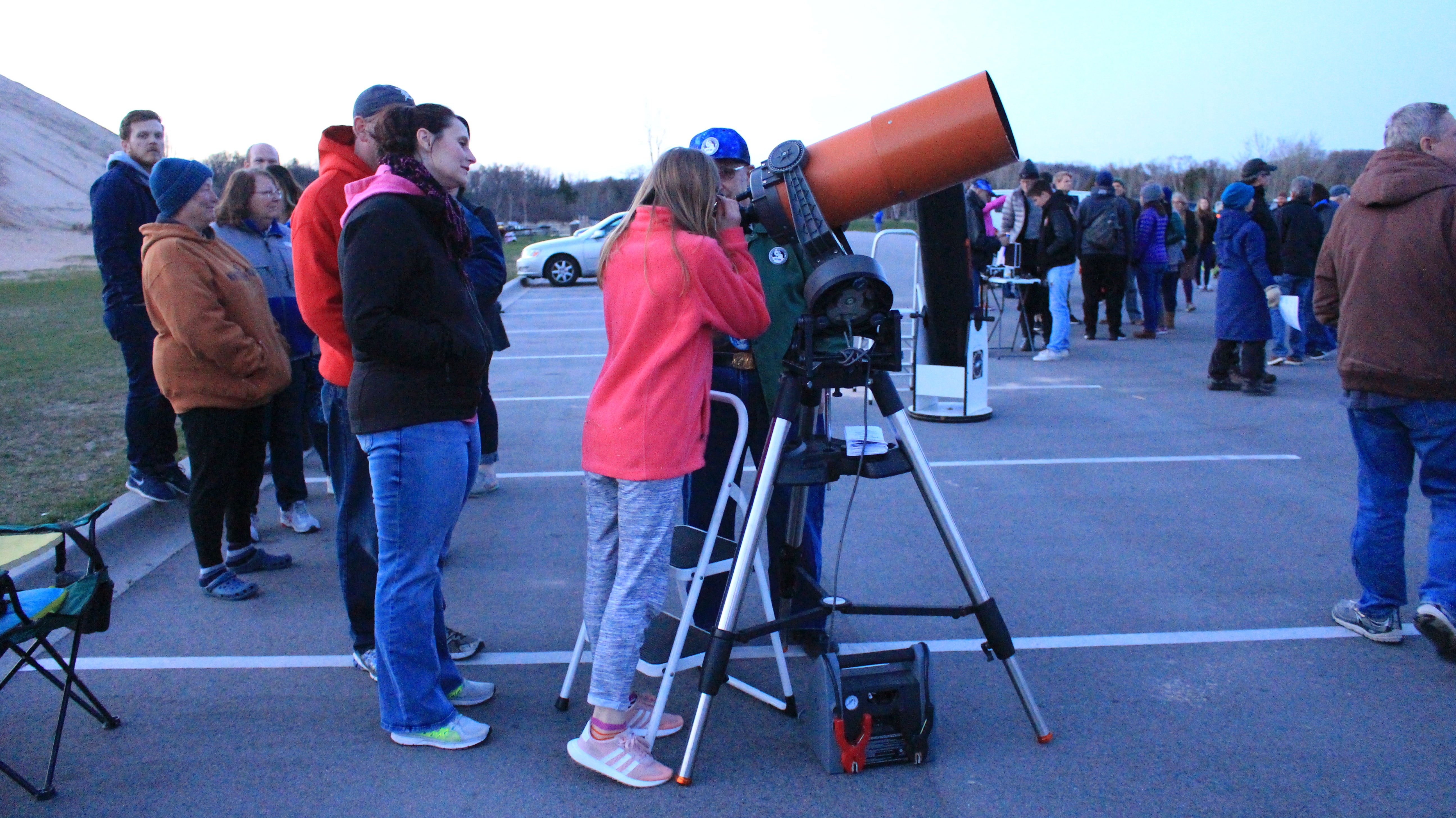 Visitors looking through large telescopes
