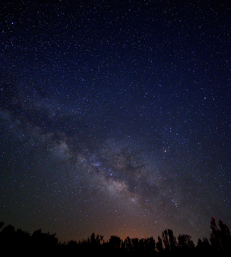 The Milky Way glows in the night sky.