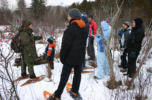 Visitors explore winter wonders off the beaten path on a Park Ranger-guided snowshoe hike at Sleeping Bear Dunes National Lakeshore.